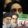 Iranian woman presents Velayeti as her choice for president Photo: AFP