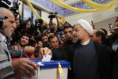 Hassan Rohani votes (Photo: MCT)