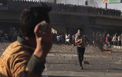 עימותים בין תומכי מורסי למתנגדיו (צילום: רויטרס)