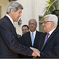 Kerry (L) and Abbas Photo: AFP