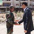 Assad with Syrian army soldier