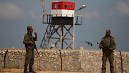 Hamas militants stand near closed gate of Rafah crossing Archive Photo: AP