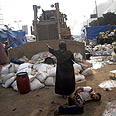 Clearing out pro-Morsi sit-in Photo: AFP