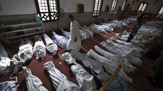 Bodies of Morsi supporters (Photo: AFP)