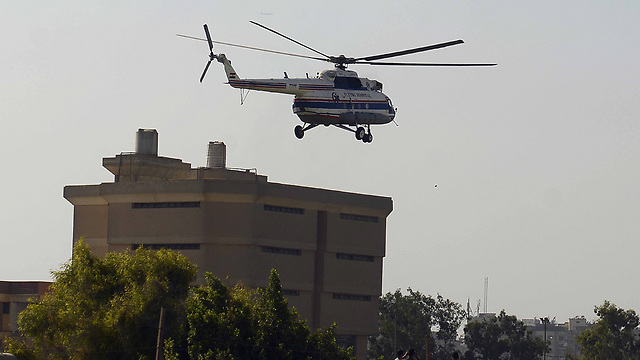 Helicopter arrives at prison (Photo: AFP)