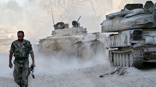 Syrian army battling rebels in Damascus (Photo: AP)