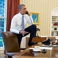 Obama at Oval Office Photo: AFP