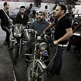 Palestinians wait in line to fill containers with fuel at petrol station in Gaza Photo: EPA