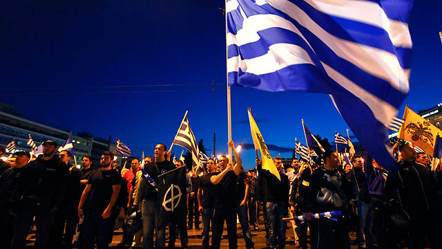 Golden Dawn members rally in Athens (Photo: Reuters)