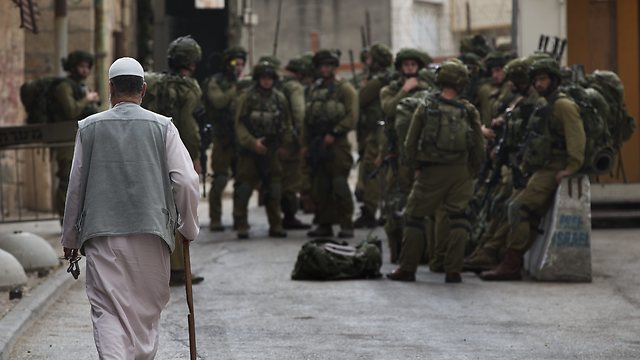 Military patrol in Hebron. Will IDF presence remain strong? (Photo: AP)