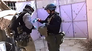UN inspectors investigating claims of chemical weapons use in Syria. Photo: EPA