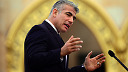 Yair Lapid speaks at conference in Budapest Photo: AFP