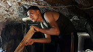 A Palestinian tunnel worker repairs a smuggling tunnel in Rafah Photo: AP