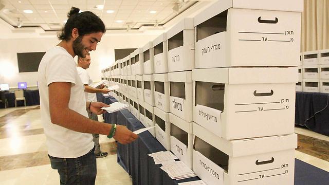 Counting ballots (Photo: Ido Erez)