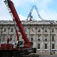 Crane collapses on British cabinet Photo: AP