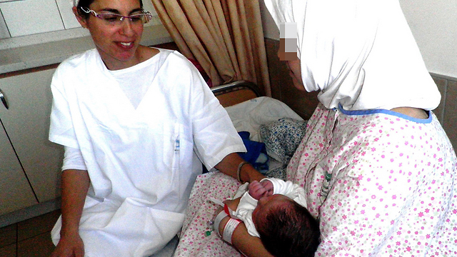 Mother and newborn in Safed hospital (Photo: Hannah Bikel)