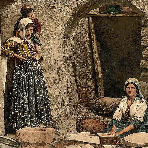 Syrian women preparing bread