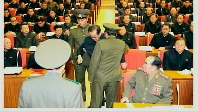 ג'אנג סונג תאק נלקח מדיון של ועידת צמרת ההנהגה (צילום: רויטרס)