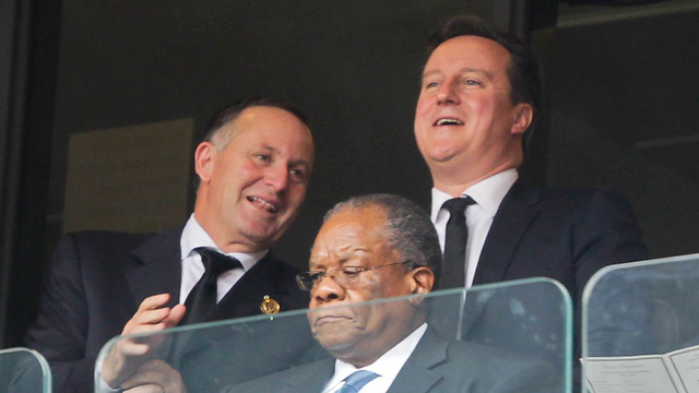 David Cameron (right) at Mandela's ceremony (Photo: EPA)