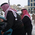 King Abdullah II of Jordan gives helping hand in snow