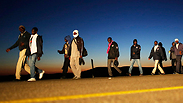 Asylum seekers leaving Holot facility Photo: Reuters