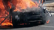 Burning car after explosion Photo: Egged