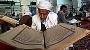 Yemeni man reads the Quran during Ramadan Photo: AFP