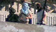 Masked settlers as shown in video Photo: B'Tselem
