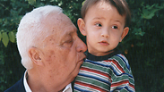 Sharon with his grandson. 'Being a human being is seeing the pain, noticing every look and concern' Photo: Shaul Golan