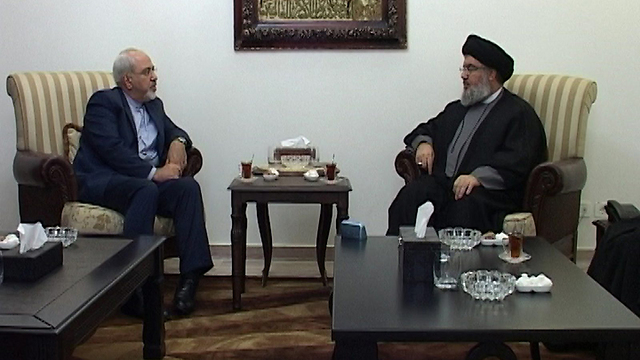 Hezbollah chief Sheikh Hassan Nasrallah with Iranian Foreign Minister Javed Zarif (Photo: AFP PHOTO / HEZBOLLAH PRESS OFFICE)