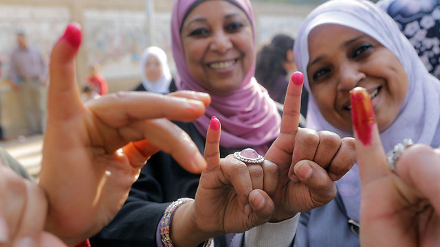 Red ink marking those who already voted (Photo: AP)