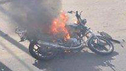 The burning motorcycle