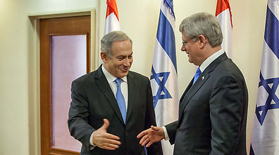 Benjamin Netanyahu and Stephen Harper (Photo: Haaretz/Pool)