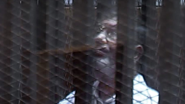 Morsi behind bars (Photo: AP)