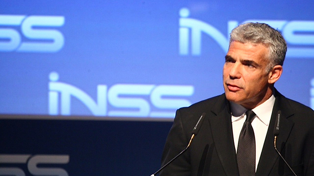 Treasury Minister Yair Lapid at the INSS (Photo: Motti Kimchi)