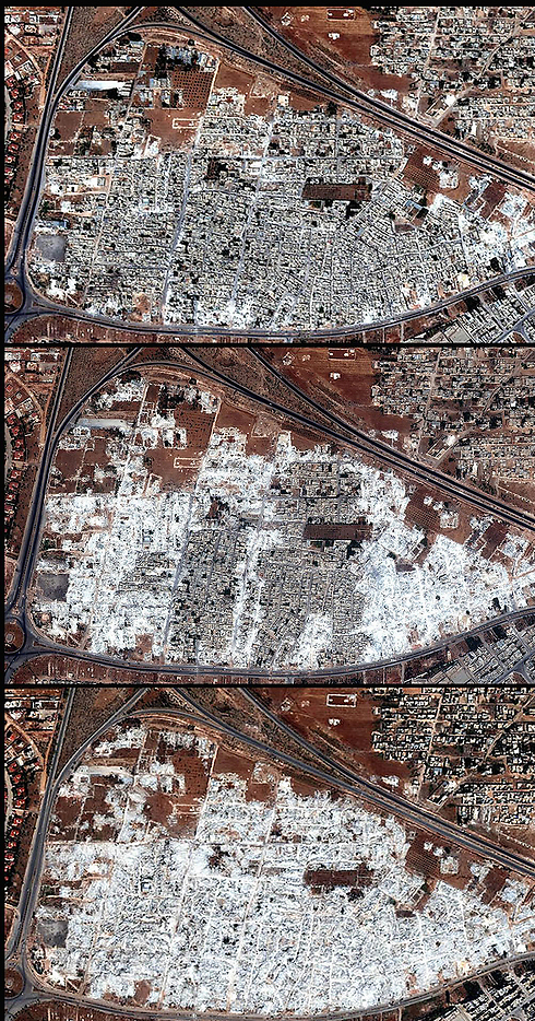 Satellite imagery of Homs after repeated bombings (Photo: AP)