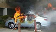 A car set ablaze near shooting scene.