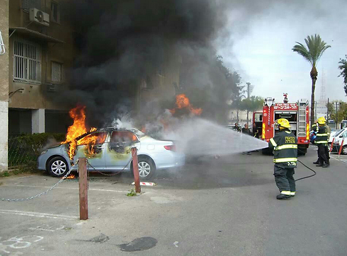 A car set ablaze in Gaza street in Jaffa.