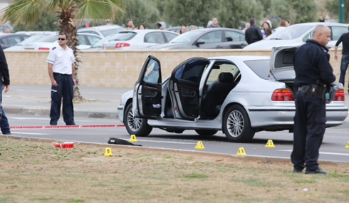 Bullets cover ground at scene of shooting (Photo: Motti Kimchi)