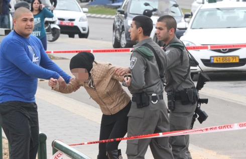 Police, family escort relative of victim away from scene (Photo: Motti Kimchi)