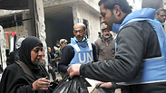UNRWA distributing food parcels at the Yarmouk refugee Palestinian camp in Damascus. Photo: EPA