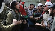 Palestinian protesters clash with IDF forces in Hebron. Photo: Reuters