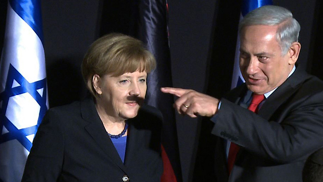 Netanyahu and Merkel in a now-famous snapshot (Photo: AFP) (Photo: AFP)