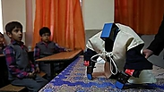 Meet robot Veldan, a Quranic term meaning: Youth of Heaven (Photo: AP) Photo: AP