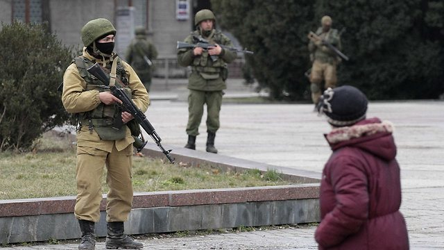 Armed men with no visible identification tags in Crimea (Photo: Reuters)