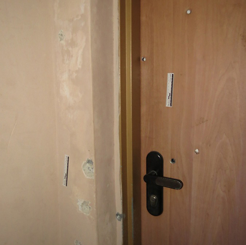 Bullet holes in imam's house (Photo: Hassan Shaalan)