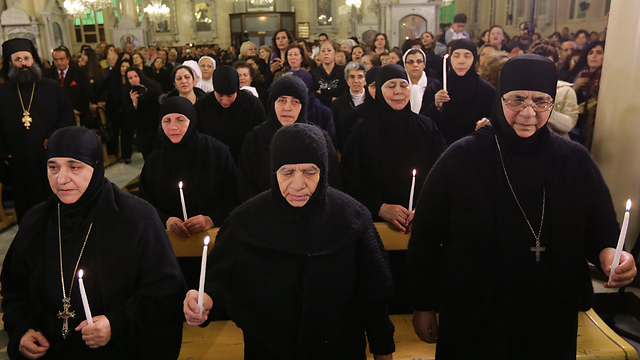 Freed nuns pray (Photo: AFP)