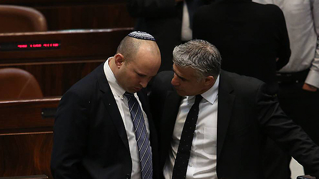 Finance Minister Yair Lapid and Economy Minister Naftali Bennett (Photo: Gil Yochanan)
