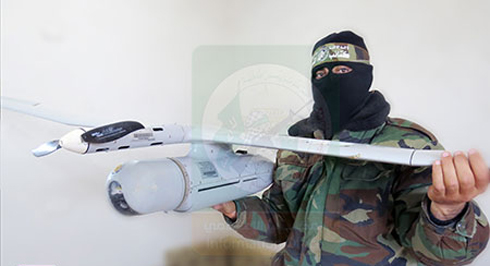 Hamas militant holds up Israeli Skylark drone that crashed earlier Tuesday