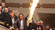 Jordanian MPs burning Israeli flag Photo: AP